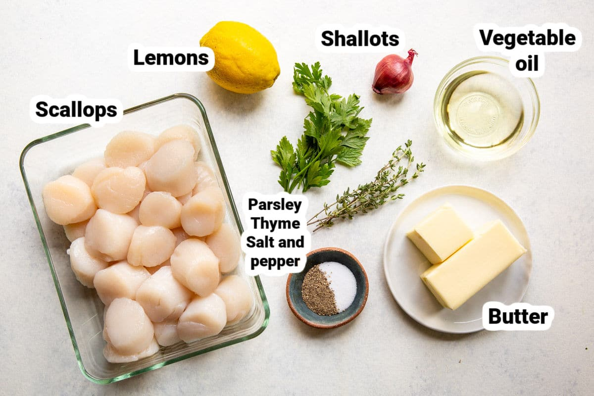 Labeled ingredients for pan-seared scallops with lemon butter.