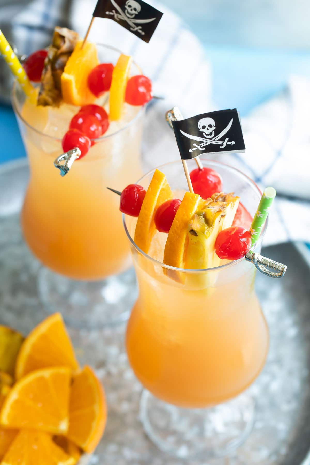 Glasses of pirate punch on a metal tray.