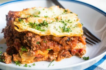 The best make ahead lasagna slice on a white plate.