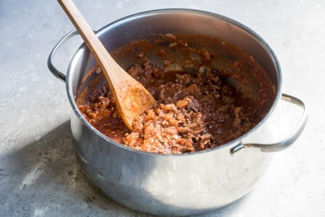 S saucepan full of homemade meat sauce.