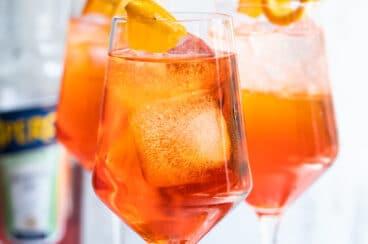 Three Aperol Spritz cocktails.