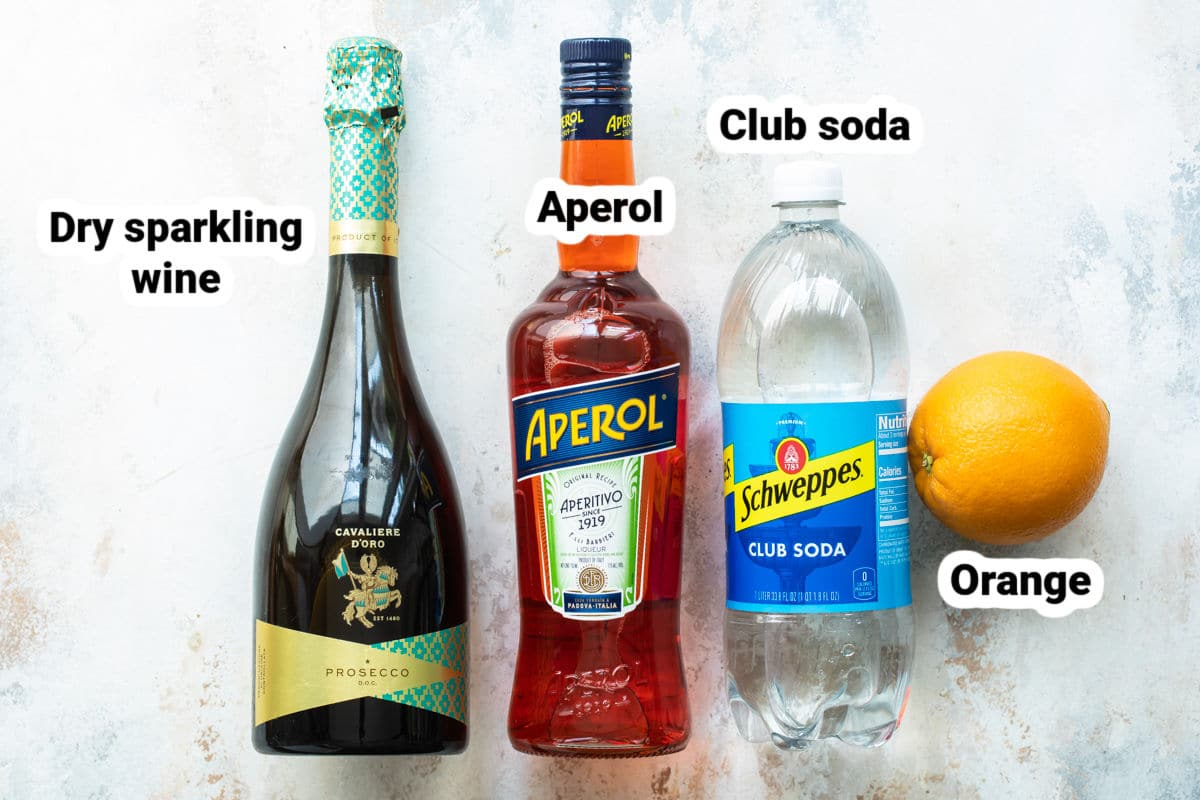 Labeled ingredients for Aperol Spritz.