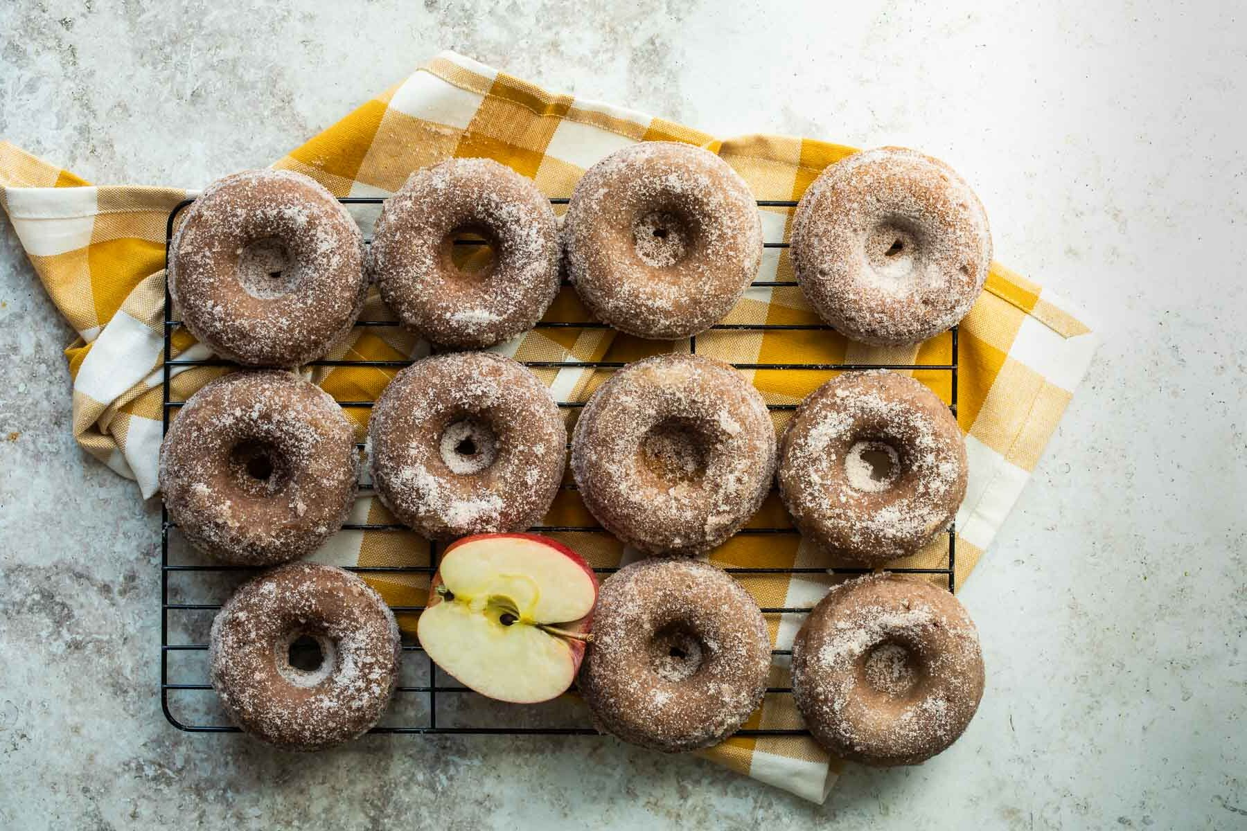 Apple cider donuts on a wire cooling rack.