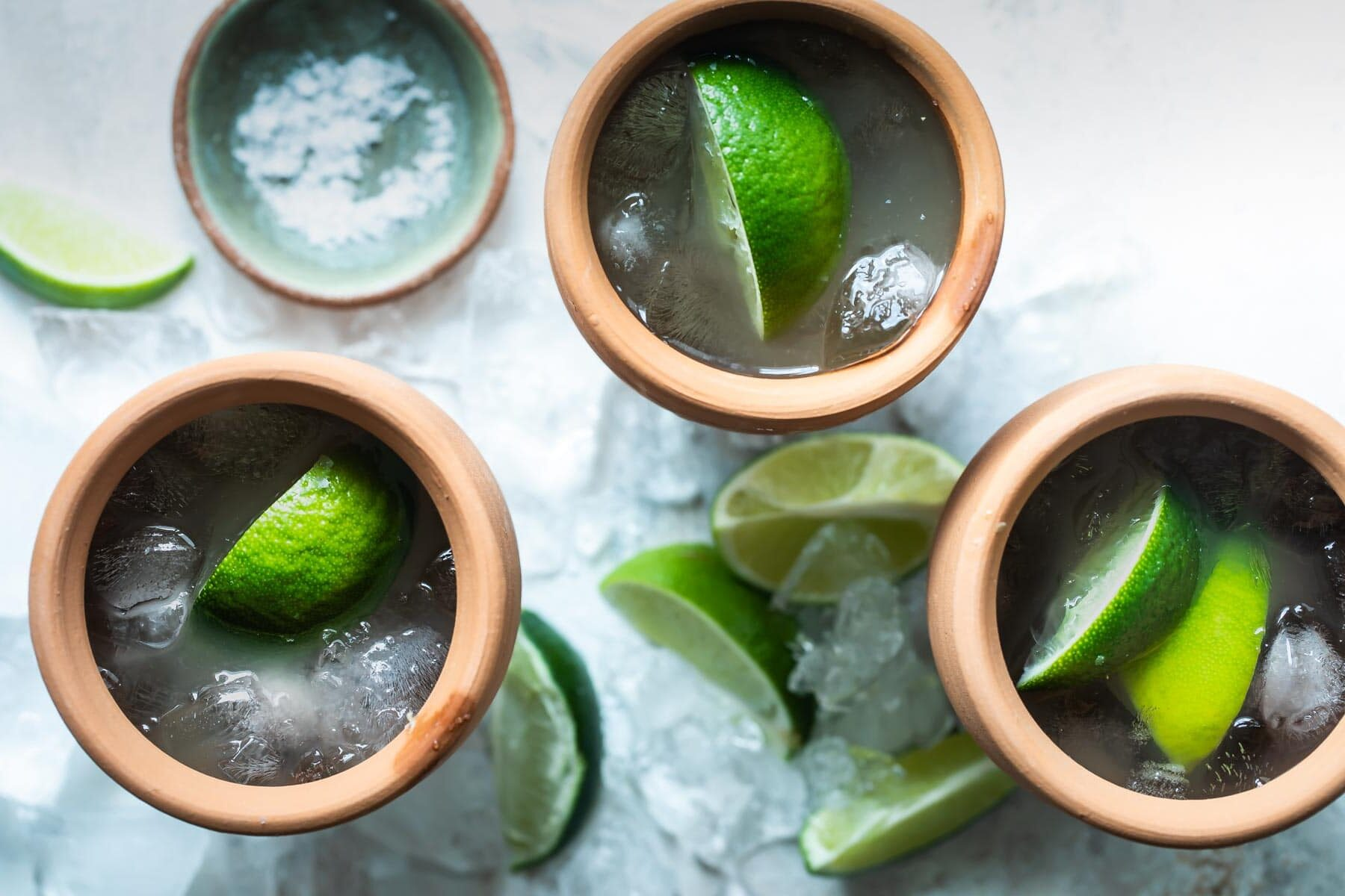 3 Cantarito cocktails in clay cups.