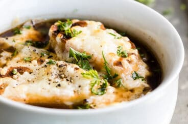 French onion soup in a white bowl.