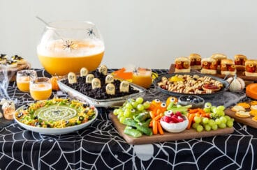 A table filled with Halloween party inspired versions of everyday recipes.