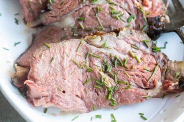 A platter of sliced prime rib.