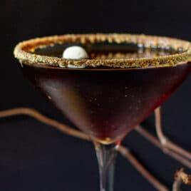 A s'mores chocolate martini in a martini glass.
