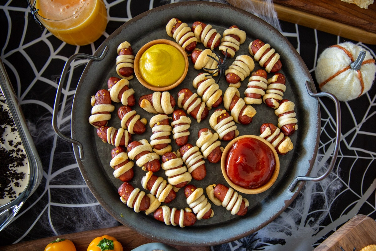 Pigs in a blanket styled as mummies for Halloween.