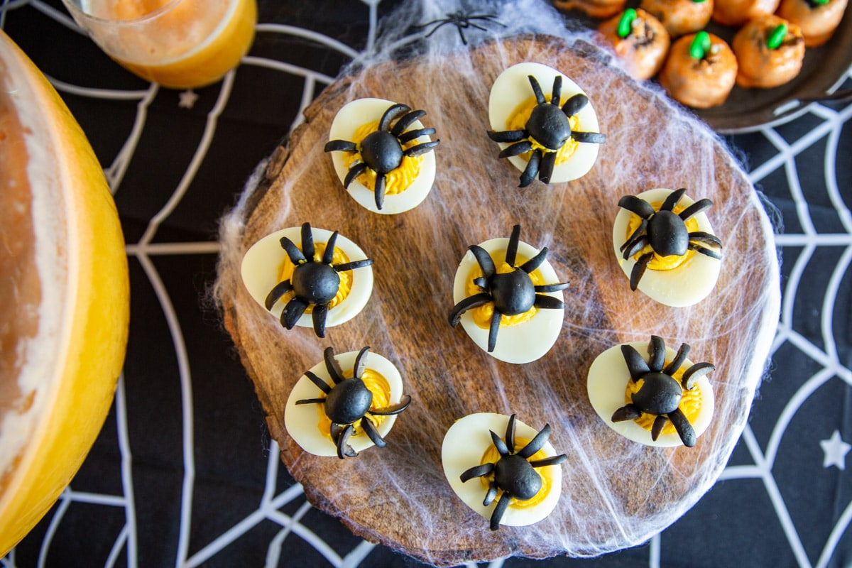 """Deviled eggs with black olive """"spiders"""" on top for Halloween."""