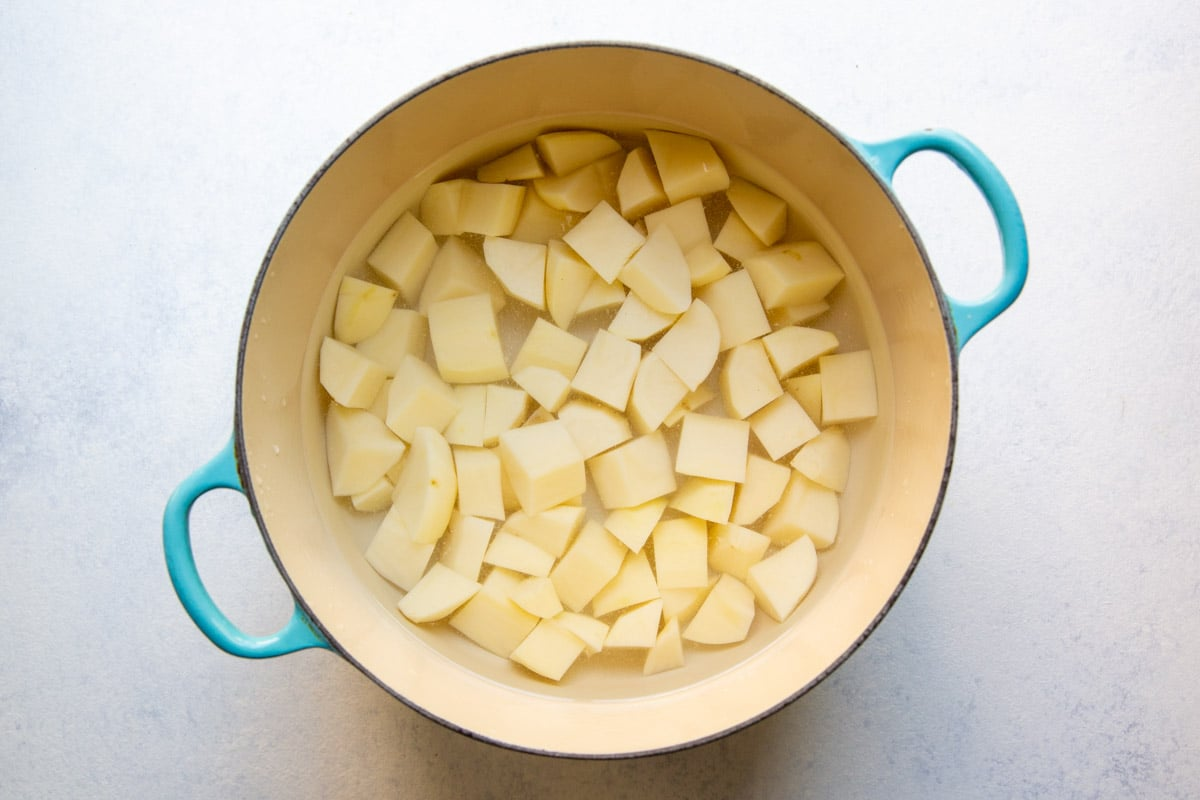 Peeled, cut potatoes in a pot for boiling.