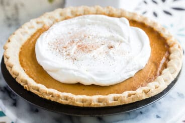 Make ahead pumpkin pie topped with whipped cream.